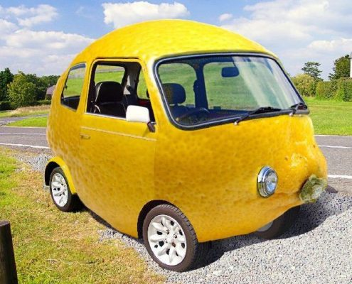 Lemon car parked on the side of the road