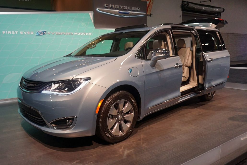 Chrysler Pacifica hybrid 2017 silver with all doors open in a showroom